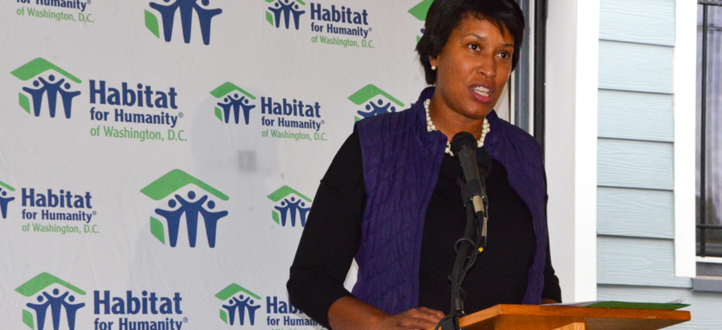 Mayor Bowser speaks during DC Habitat's Home Dedication in Ivy City.