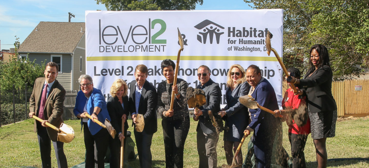 Mayor Muriel Bowser helps break ground on 12 new homes in Ivy City along with DC Habitat staff and board members, community leaders, and Level 2 Principal David Franco.