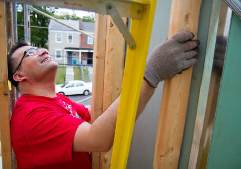 A DC Habitat volunteer helps frame a house on our 46th Street SE project.