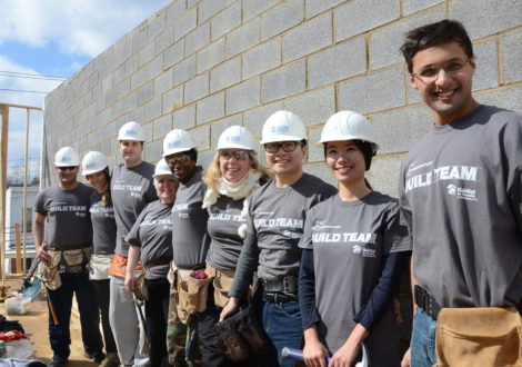 Promontory employees volunteer on a DC Habitat site.