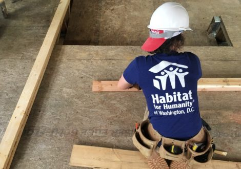 A DC Habitat volunteer helps frame a new house in SE DC.