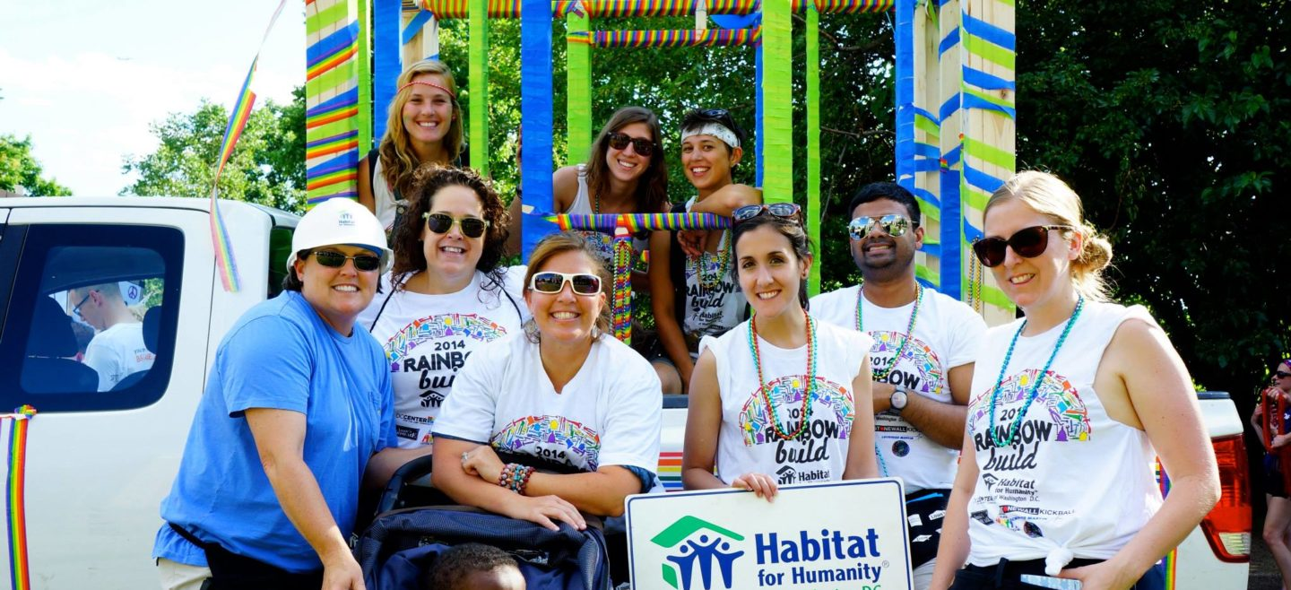 DC Habitat staff and Rainbow Build volunteers pose in front of the 2014 DC Pride Parade float.