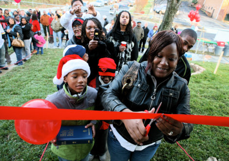 A DC Habitat family cuts the ribbon on their new home.