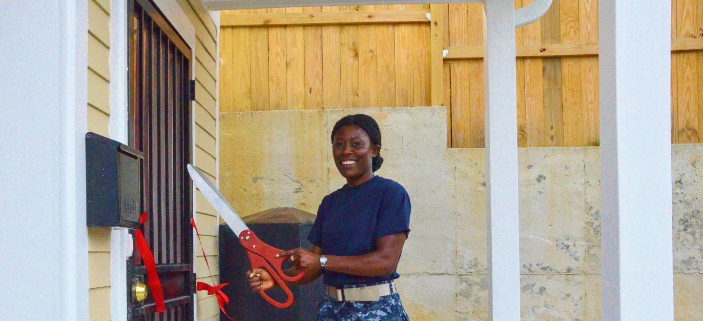 DC Habitat Homeowner Bridget cuts the ribbon on her new home