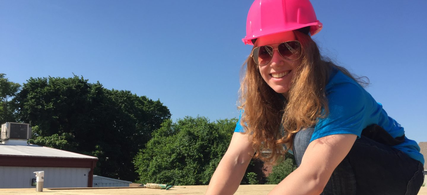 A Women Build volunteer works on sheathing a new home.