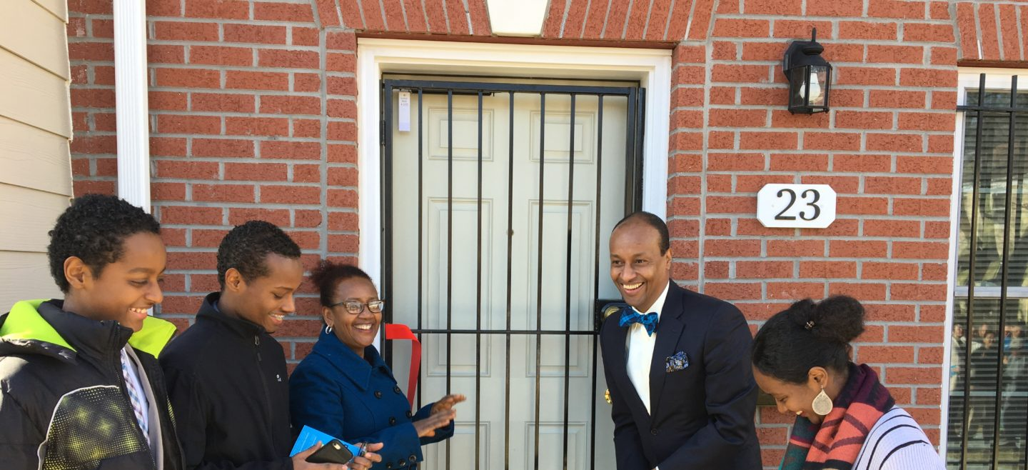 The Ayele Family cuts the ribbon on their new home